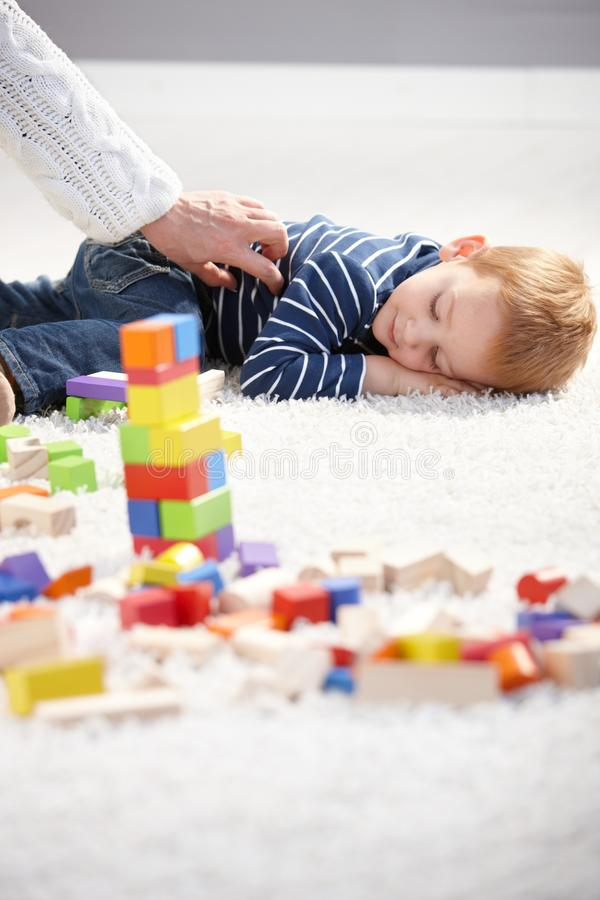 Download Little Boy Getting Tired In Playing Stock Photo - Image of ginger, boys: 20857606