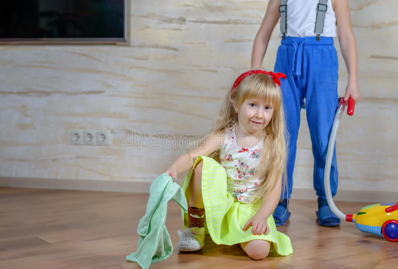 Little Boy and Girl Cleaning at Home Together royalty free stock photography