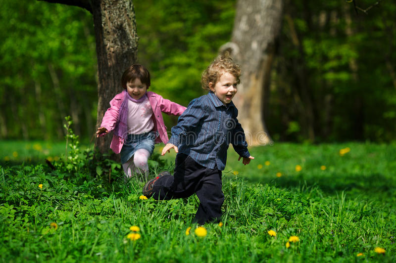 Download Little Boy And Girl Running Away Stock Photo - Image of playground, preschool: 29466036