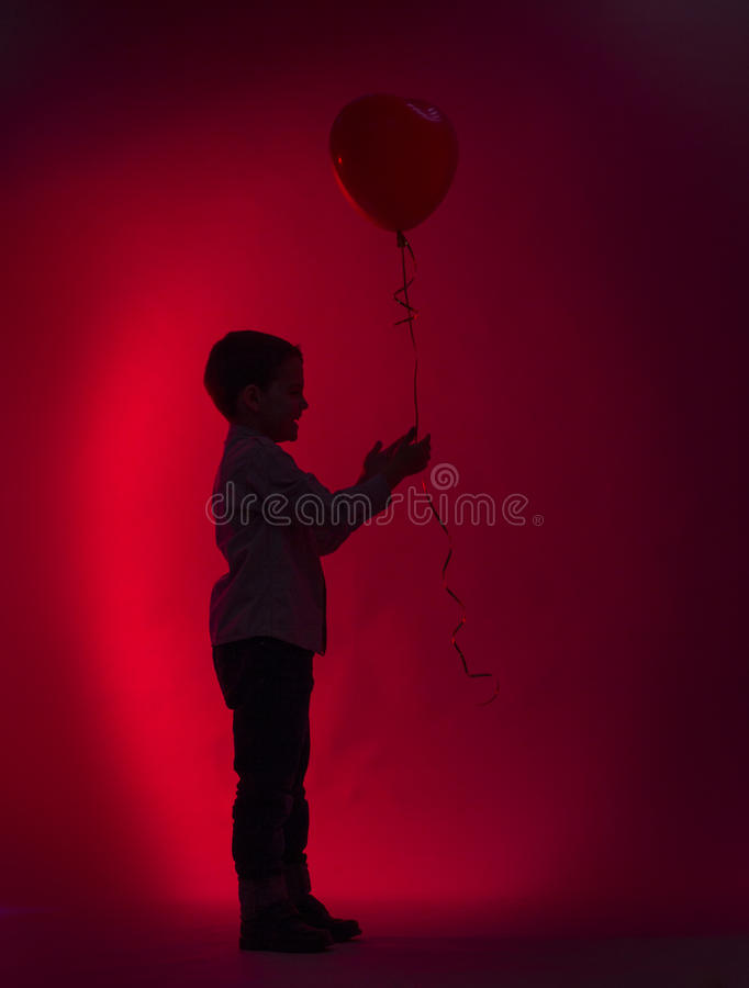 Little boy giver balloon royalty free stock photo