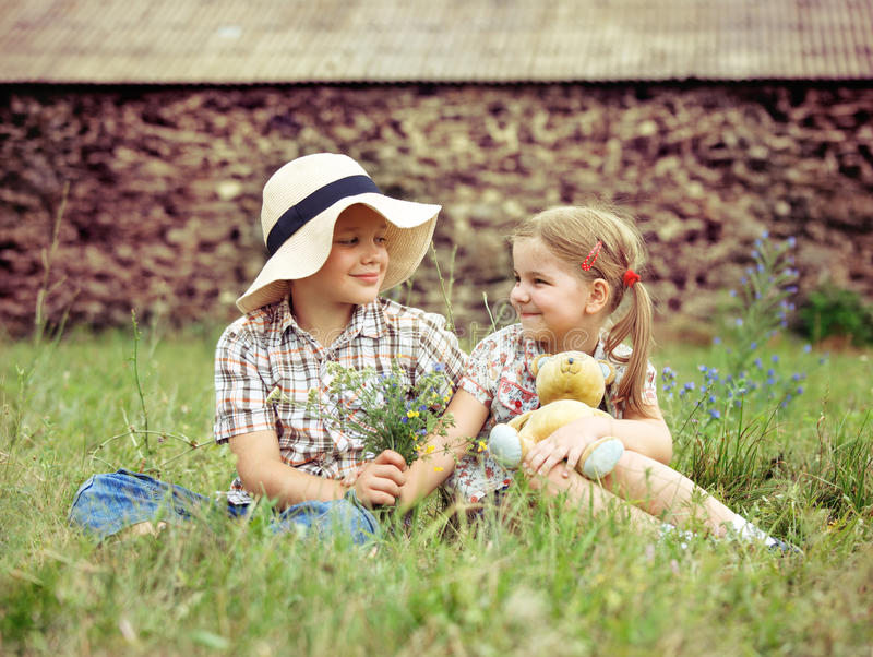 Download Little Boy Gives Flowers To The Little Girl Stock Photo - Image: 28534424