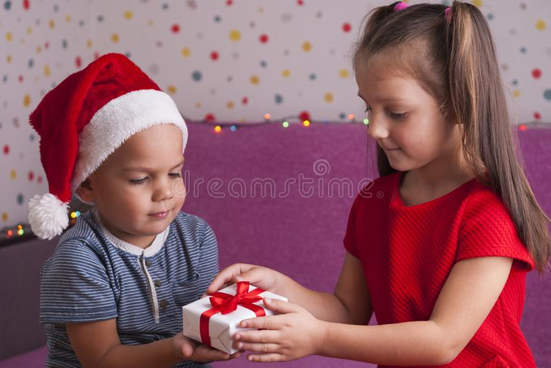 Boy gives a gift stock photo