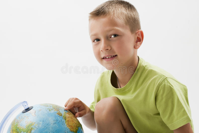 Download Little boy with globe stock image. Image of isolated - 25826437