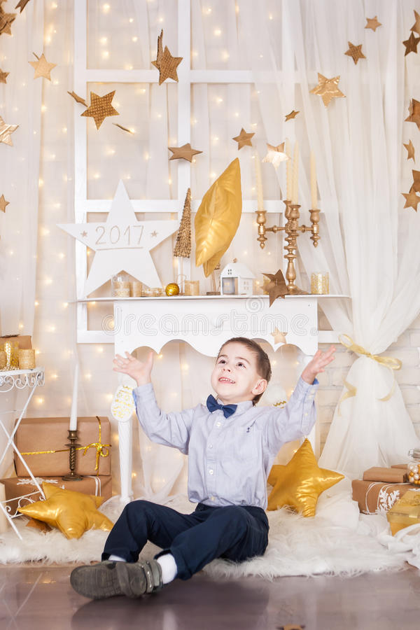 Little boy in a gold Christmas decorations stock photos