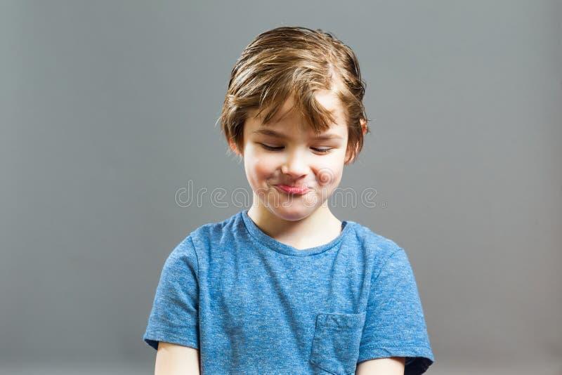 Little Boy-Grappige Uitdrukkingen - giecheel stock afbeeldingen