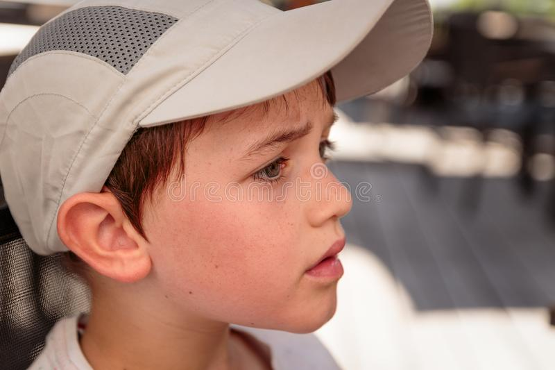 Little boy with gray baseball hat stock image
