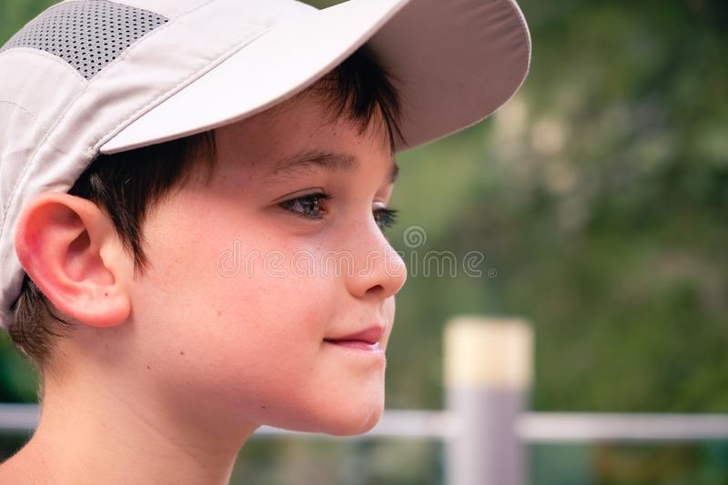 Little boy with gray baseball hat stock photography