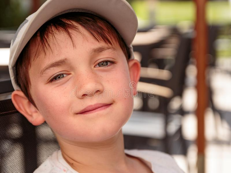 Little boy with gray baseball hat royalty free stock image