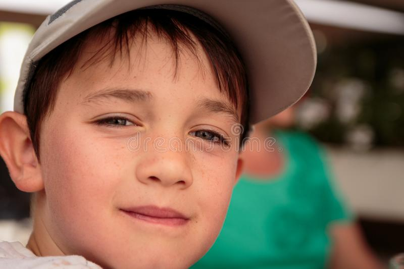 Little boy with gray baseball hat royalty free stock photos