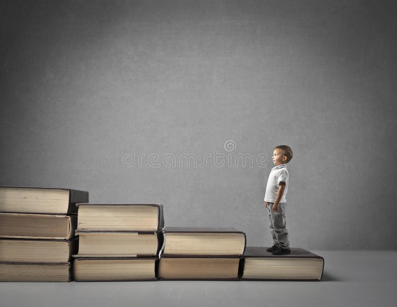 Little boy growing up. A little boy growing up stock images