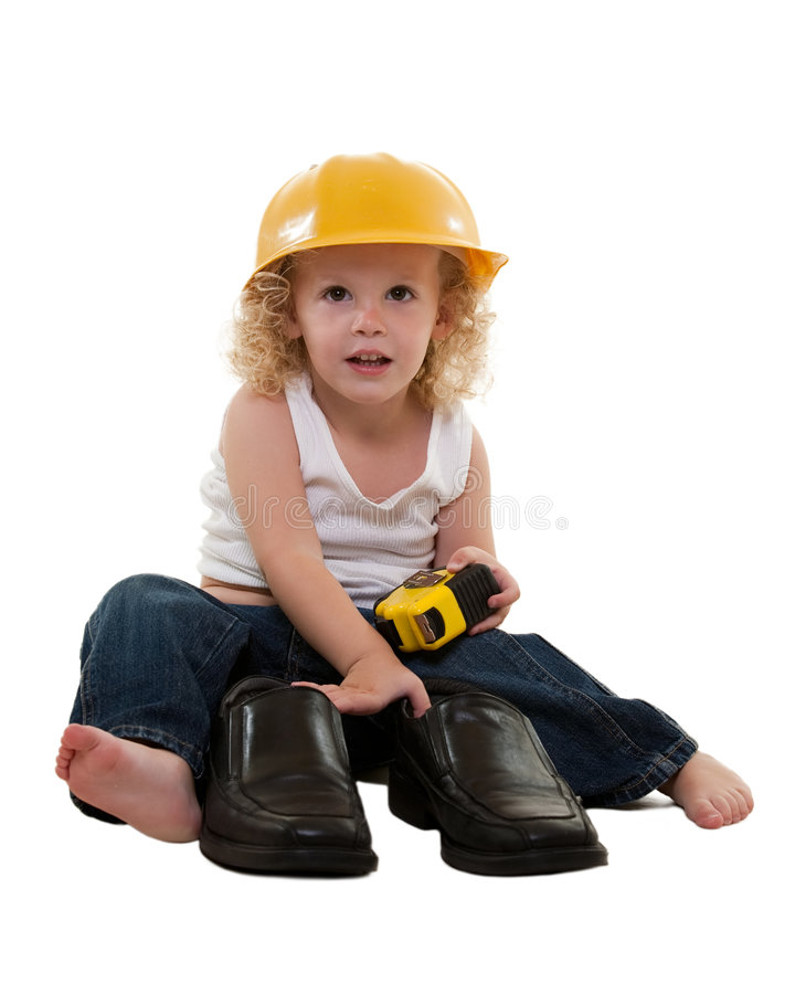 Little boy with grown up man shoes stock photos