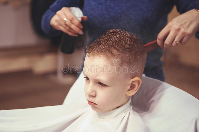 Little Boy At The Hairdresser Child Is Scared Of Haircuts Hair