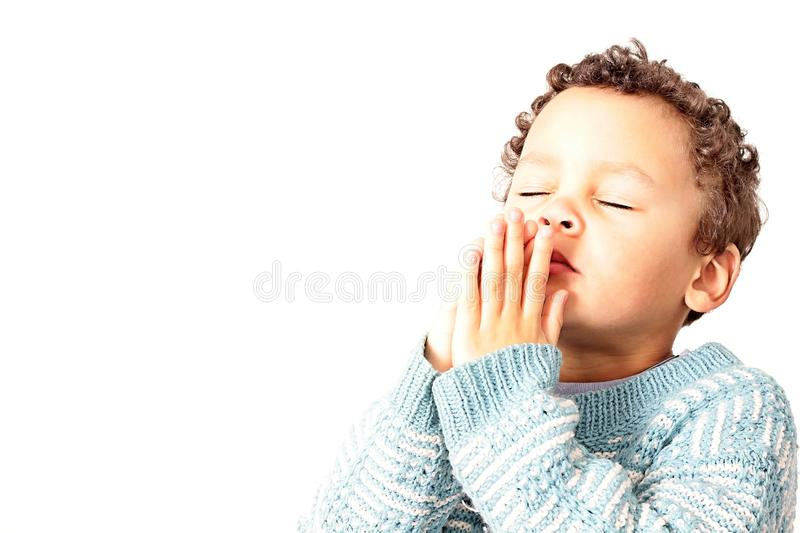 Little boy with hands together praying royalty free stock photos