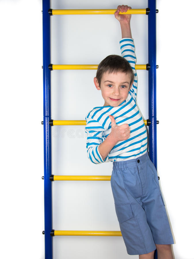 Little boy hanging on the one hand royalty free stock photos