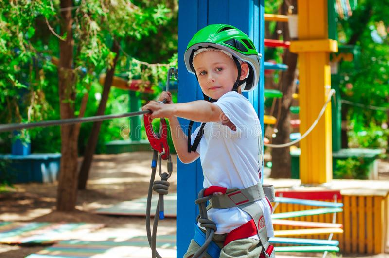A little boy exploring an adventure rope park stock photo