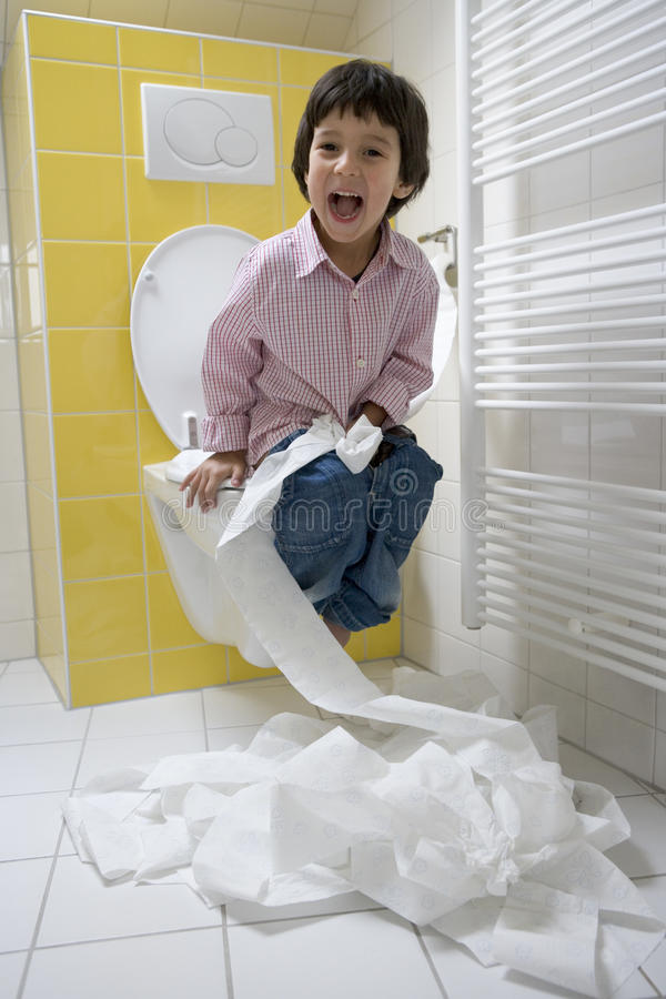 Download Little Boy Has A Lot Of Fun With Toilet-paper In Royalty Free Stock Photos - Image: 11309208