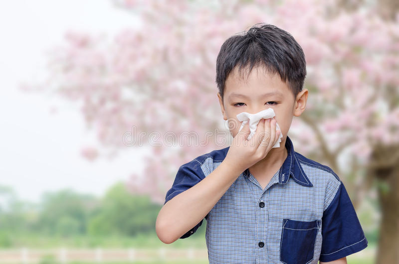 Little boy has running nose from allergies stock photo