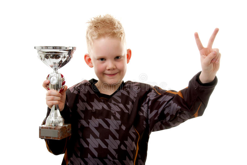 Little boy has won the second place trophy cup royalty free stock image