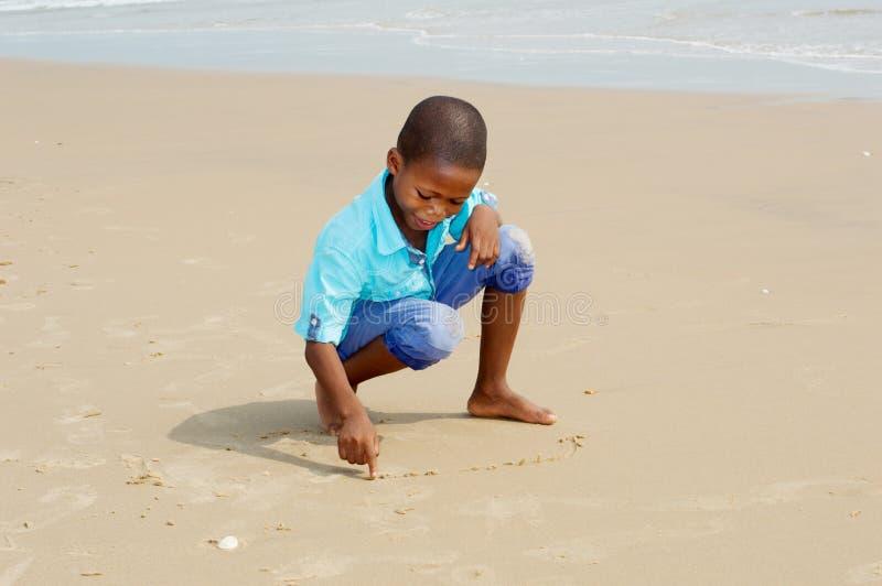 Little boy having fun at the beach stock image