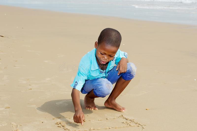 Little boy having fun at the beach royalty free stock photography