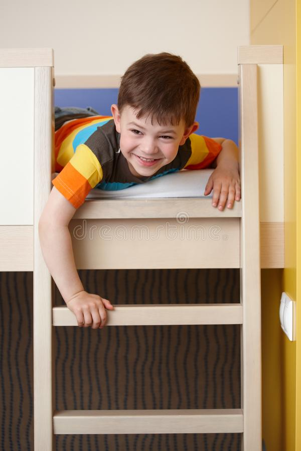Little boy having fun on bunk bed laughing stock photos