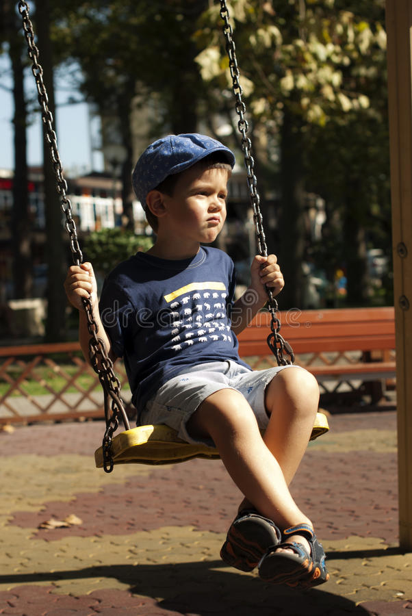 Little boy having fun at the playground royalty free stock photo