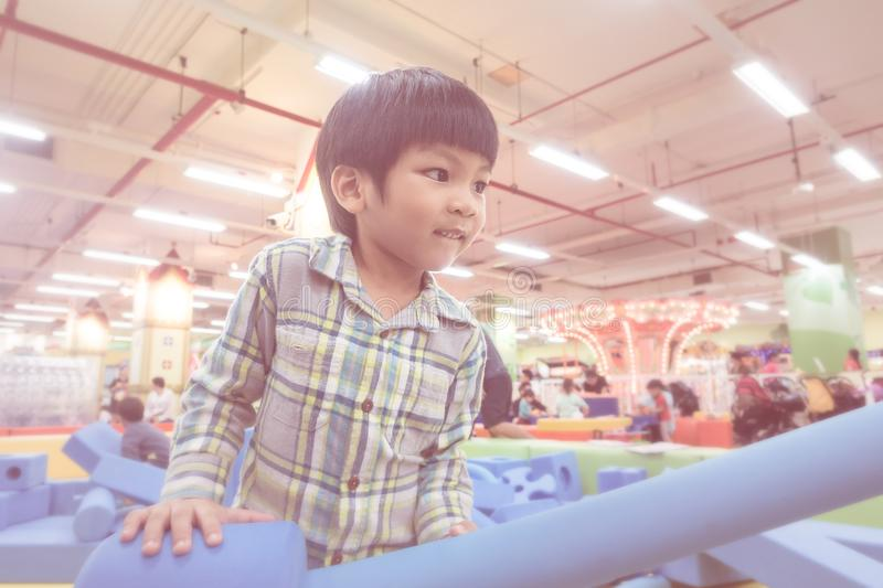 Little boy having fun playing in indoor playground. Little boy is having fun playing in indoor playground royalty free stock photography