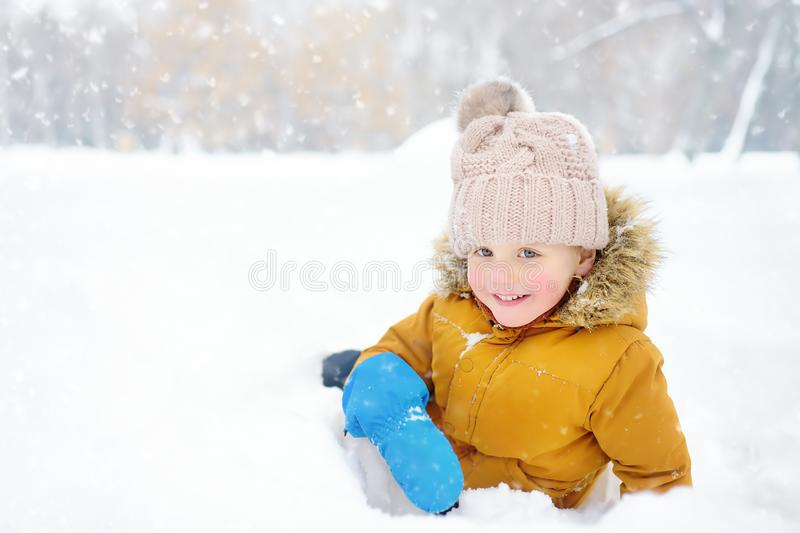 Little boy having fun in the snow. Cute little boy having fun in the snow. Outdoors winter activities for kids stock images