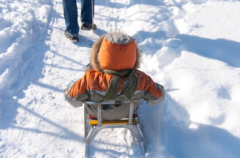 Little boy having fun in the snow stock images