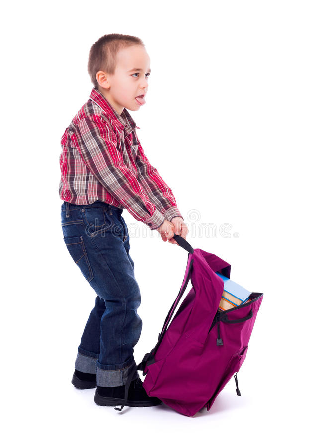 Little boy with heavy schoolbag stock images