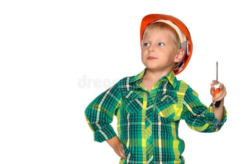 The little boy in the helmet of the builder. royalty free stock photos