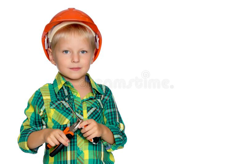 The little boy in the helmet of the builder. royalty free stock images