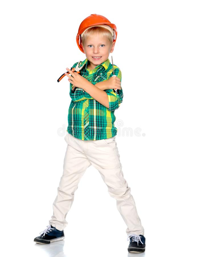 The little boy in the helmet of the builder. stock photography