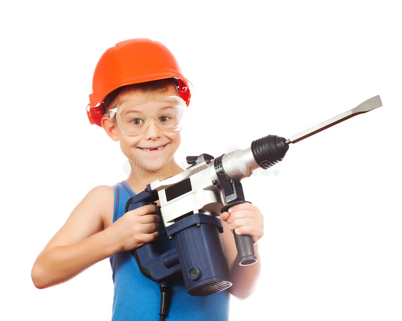 Little boy in a helmet with electric hammer royalty free stock photography