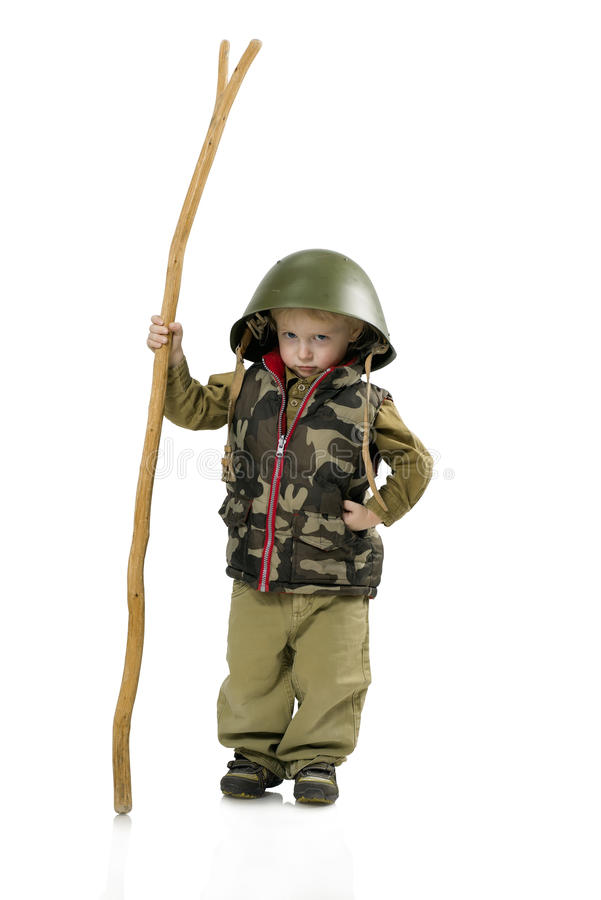 Little boy in helmet and uniform stock photography