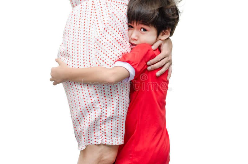Little boy is hiding his mother with scary. On white background stock photos