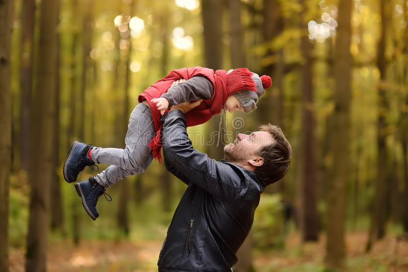 Little boy with his father during stroll in the forest royalty free stock photo