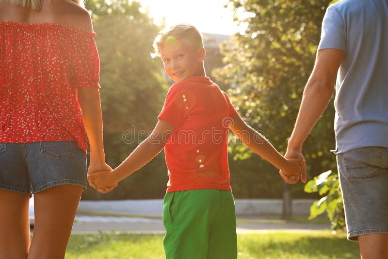 Little boy and his parents holding hands. Family weekend royalty free stock photography