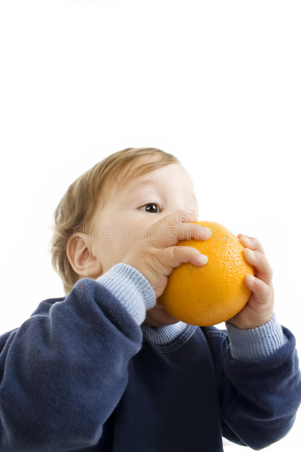 Download Little boy hold a orange. stock image. Image of person - 14358177