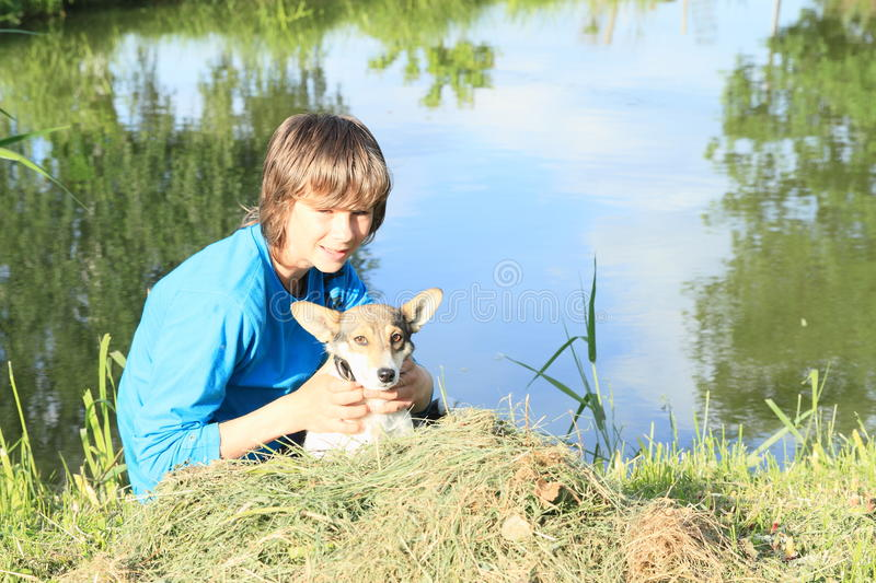 Little boy holding a dog stock photography
