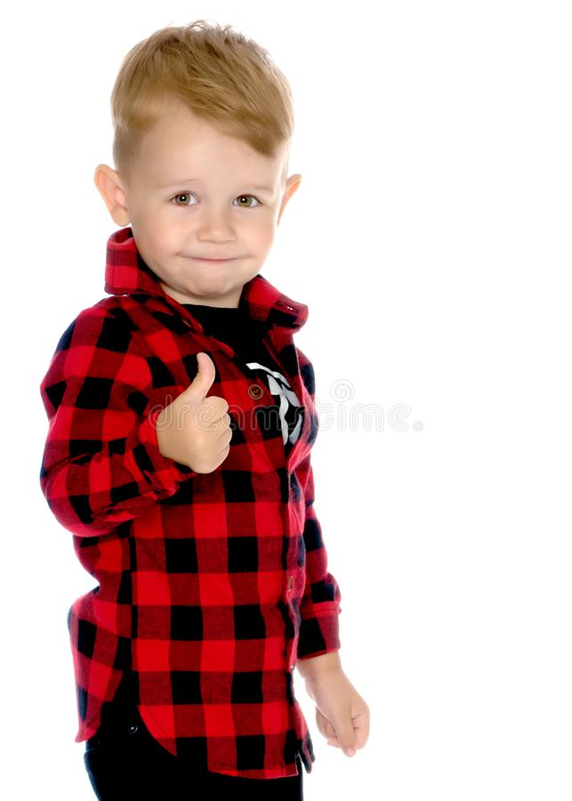 A little boy is holding a finger up. stock photos
