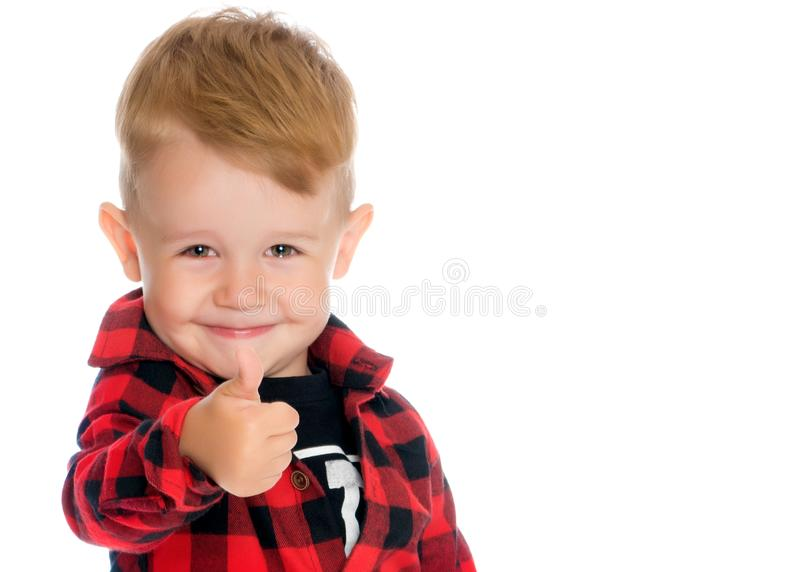 A little boy is holding a finger up. stock photo
