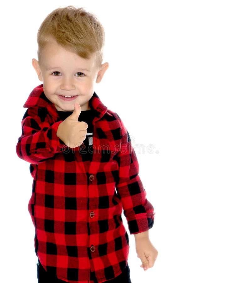 A little boy is holding a finger up. stock image