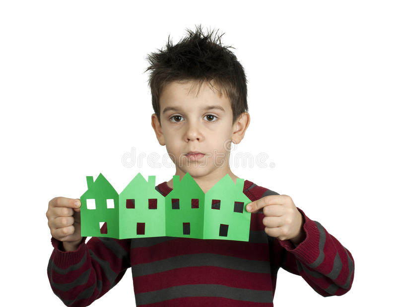 Little boy holding houses made of paper stock photography