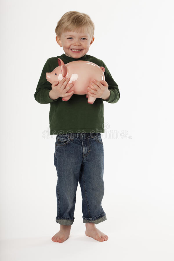 Download Little Boy Holding A Piggy Bank Stock Photo - Image: 15762282