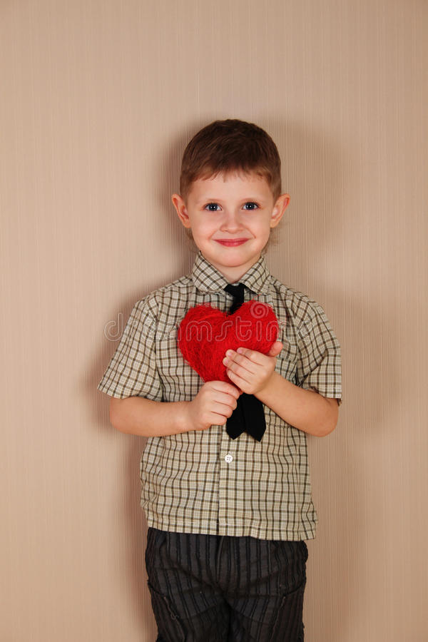 Download Little Boy Holding A Read Heart Stock Image - Image: 27682951