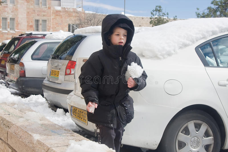 Little Boy Holding Snow Editorial Stock Image