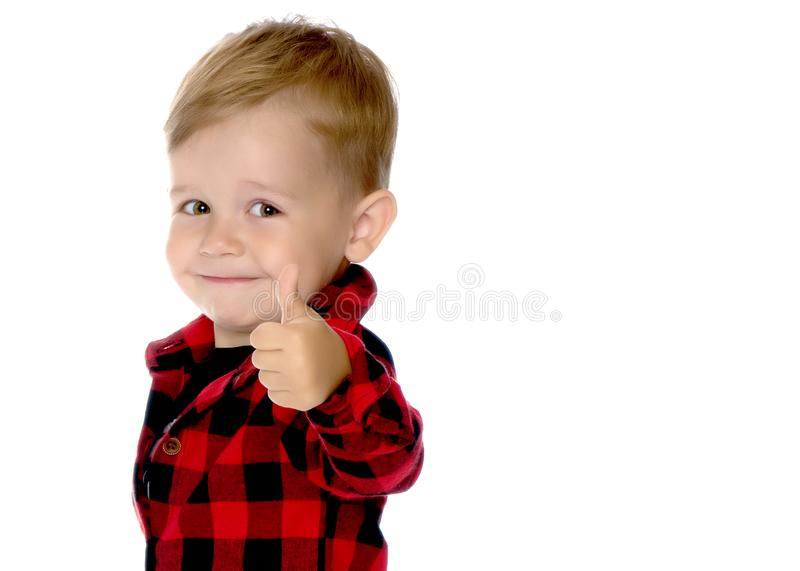 A little boy is holding a finger up. stock photography