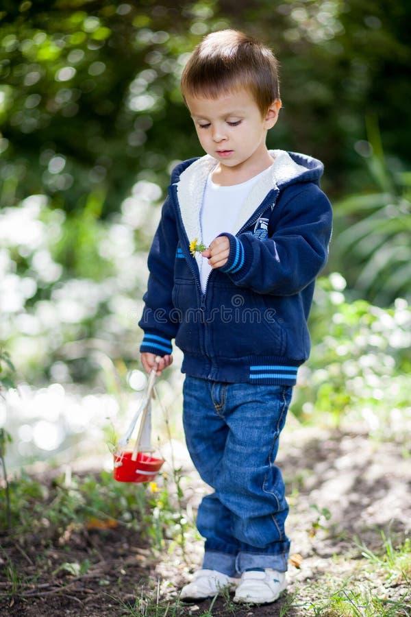 Little boy, holding toy boat stock image