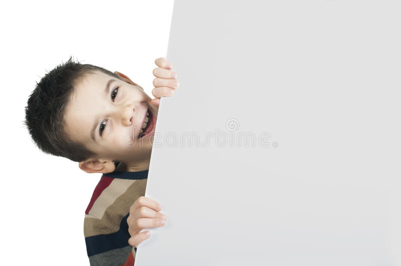 Little boy holding a whiteboard stock image